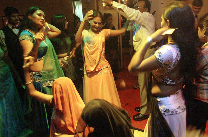 "Indian bar girls perform at a dance bar in Bombay May 5, 2005. The government of the western Indian state of Maharashtra on Wednesday endorsed the decree seeking to ban dance bars in the state. There are more than 600 dance bars in Bombay itself and the closure of cabarets is likely to render jobless more than 150,000 people across the state including dancers, waiters, bouncers and security guards. Most bars in the state employ girls, who dress in colourful costumes and dance to Bollywood numbers, as customers showers them with bills. According to bar girl's union, majority of the 75,000 girls working in bars will be forced into the ""flesh trade"" due to the closure. Picture taken on May 5, 2005. REUTERS/Punit Paranjpe  AD/LD - RTRBMB5"