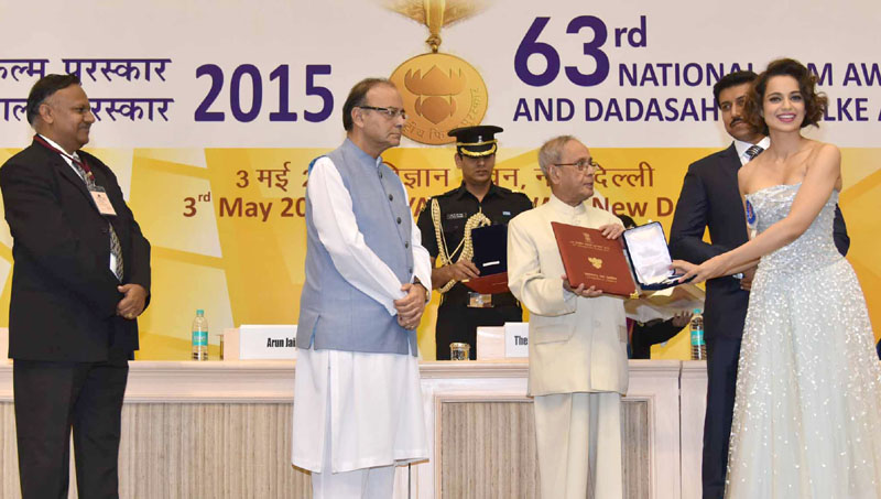 The President, Shri Pranab Mukherjee presenting the Rajat Kamal Award to the Actress Ms. Kangana Ranaut (Best Actress) for Tanu Weds Manu, at the 63rd National Film Awards Function, in New Delhi on May 03, 2016. The Union Minister for Finance, Corporate Affairs and Information & Broadcasting, Shri Arun Jaitley, the Minister of State for Information & Broadcasting, Col. Rajyavardhan Singh Rathore and the Secretary, Ministry of Information & Broadcasting, Shri Ajay Mittal are also seen.