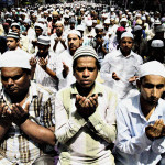 Indian Muslims offer last Friday pray of the holy month of Ramadan, in Kolkata, India, Friday, Aug. 2, 2013. Muslims throughout the world are marking the month of Ramadan, the holiest month in Islamic calendar during which devotees fast from dawn till dusk. (AP Photo/Bikas Das)