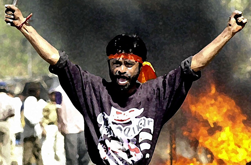 (FILES) This picture taken 28 February 2002 shows an IndianBajranj Dal activist armed with a iron stick shouting slogans against muslims as they went burning muslim shops and attacked residences at Sahapur in Ahmedabad, in revenge for the 27 February 2002, attack by a Muslim mob on a train carrying Hindu activists that left 58 people dead in the Northern state of Gujarat. Top police official  R. B. Sreekumar in an explosive testimony has said the anti-Muslim riots that raged in India's Gujarat state two years ago was backed by its ruling Hindu nationalist government, officials reported 18 August 2004.The 172-page testimony was unveiled a day after India's Supreme Court Tuesday reopened 2,000 cases from the riots which claimed the lives of more than 2,000 people, mostly Muslims, in the western Indian state. AFP PHOTO/ Sebastian D'SOUZA