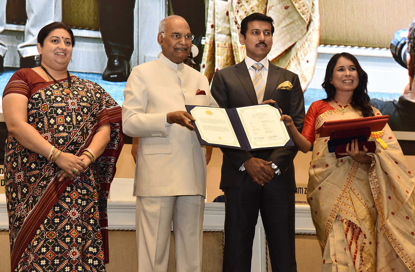 The President, Shri Ram Nath Kovind presenting the Swarna Kamal Award to the director Rima Das, for best Assamese feature film – VILLAGE ROCKSTARS, at the 65th National Film Awards Function, in New Delhi on May 03, 2018. 	The Union Minister for Textiles and Information & Broadcasting, Smt. Smriti Irani and the Minister of State for Youth Affairs and Sports (I/C) and Information & Broadcasting, Col. Rajyavardhan Singh Rathore are also seen.